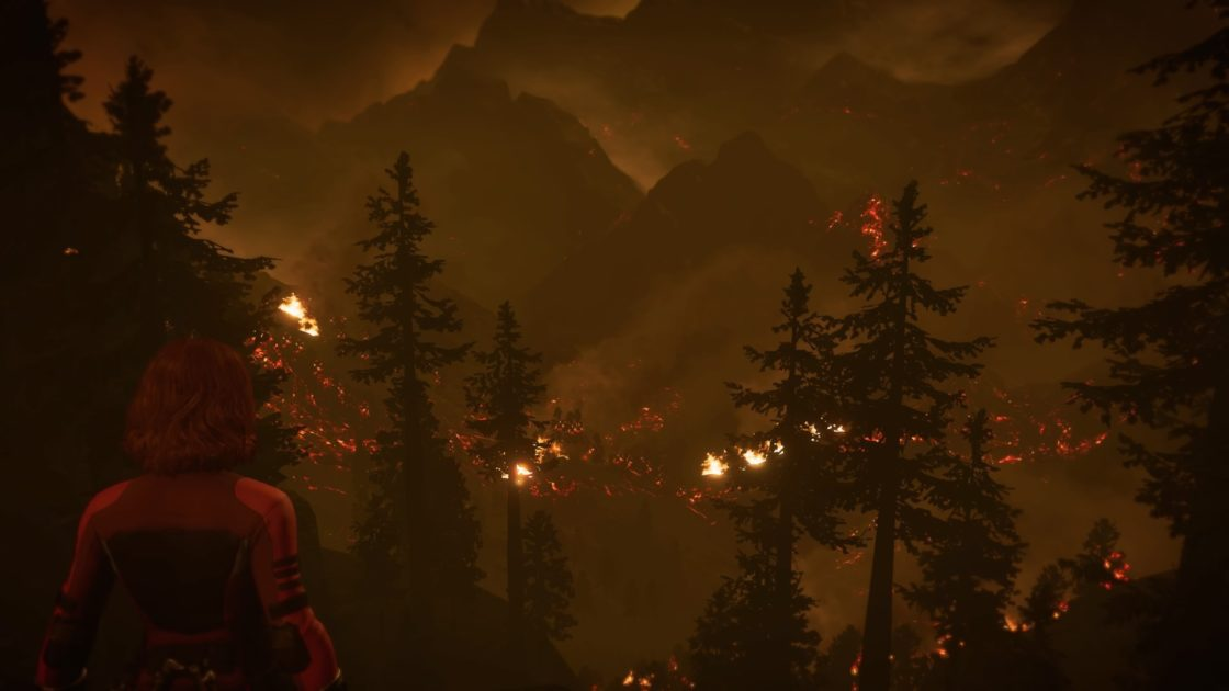 Black Widow stares out into a burning forest countryside.