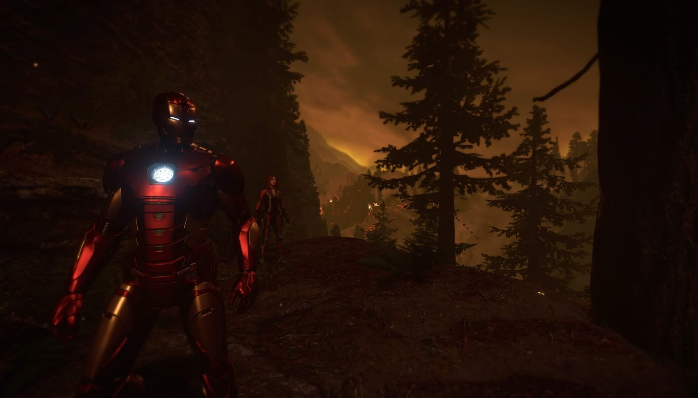 Iron Man and Black Widow stand in a forest at dusk.