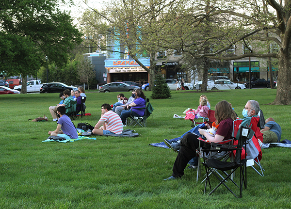 Audience members are shown waiting on Renner Lawn for the premiere of the movie.